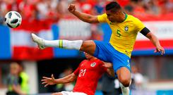 Casemiro puts his best foot forward against Stefan Lainer during yesterday's friendly between Brazil and Austria in Vienna. Photo: Reuters