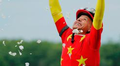 Mike Smith celebrates after partnering Justify to victory in the Belmont Stakes. Photo: Reuters