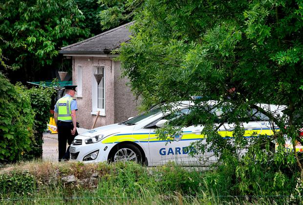 Gardai at the house in Maglin, Ballincollig, where Mikolaj Wilk was killed and his partner Elzbieta seriously injured