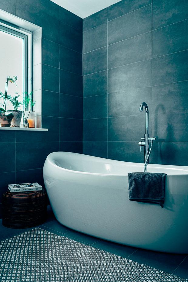 Lauren created a moody bathroom with midnight-blue tiles on both the walls and floor