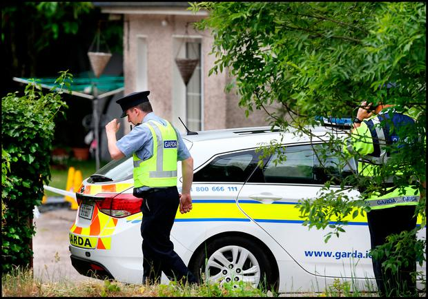 Gardai at the house in Maglin in Ballincollig Cork where a man and his partner were attacked resulting in the man's Pic Steve Humphreys