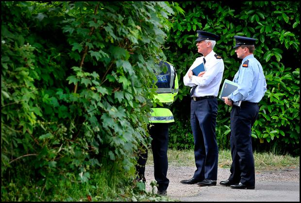 Garda Supt. Colm O'Sullivan (Centre) pictured alongside Garda Inspector Gary McPolin (right) speaking to gardai at the scene of the murder at Maglin, Balincollig Co Cork. Pic Steve Humphreys