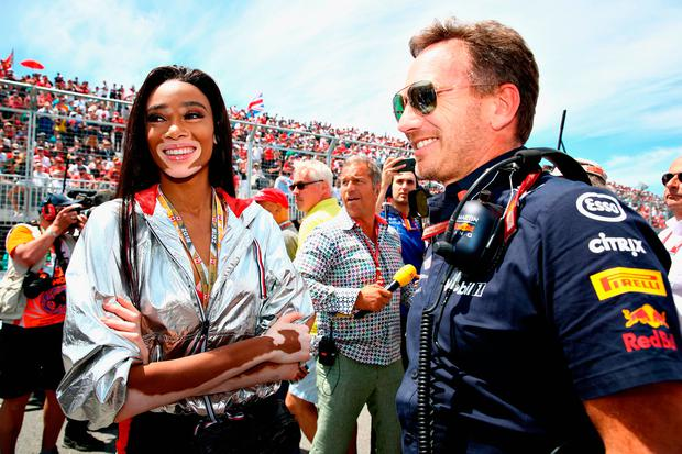 Red Bull Racing Team Principal Christian Horner talks with model Winnie Harlow on the grid before the Canadian Formula One Grand Prix at Circuit Gilles Villeneuve on June 10, 2018 in Montreal, Canada. (Photo by Mark Thompson/Getty Images)
