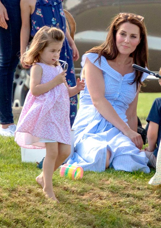 The Duchess of Cambridge with Princess Charlotte, as her husband the Duke of Cambridge takes part in the Maserati Royal Charity Polo Trophy at the Beaufort Polo Club, Downfarm House, Westonbirt, Tetbury. PRESS ASSOCIATION Photo. Picture date: Sunday June 10, 2018. See PA story ROYAL Polo. Photo credit should read: Steve Parsons/PA Wire