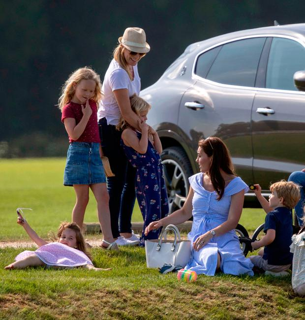 The Duchess of Cambridge with Prince George and Princess Charlotte and Autumn Phillips and her children, Savannah and Isla, as her husband the Duke of Cambridge takes part in the Maserati Royal Charity Polo Trophy at the Beaufort Polo Club, Downfarm House, Westonbirt, Tetbury