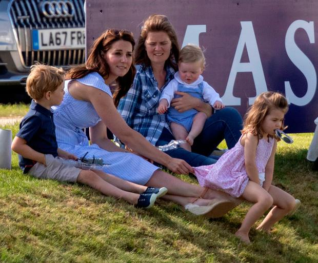 The Duchess of Cambridge (left) with Prince George and Princess Charlotte, as her husband the Duke of Cambridge takes part in the Maserati Royal Charity Polo Trophy at the Beaufort Polo Club, Downfarm House, Westonbirt, Tetbury