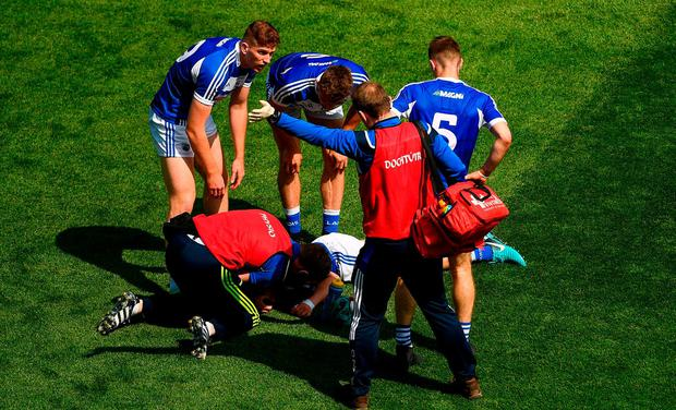 Stephen Attride of Laois gets medical attention after accidentally colliding with Ciarán Moran of Carlow during the Leinster GAA Football Senior Championship Semi-Final match between Carlow and Laois at Croke Park in Dublin. Photo by Piaras Ó Mídheach/Sportsfile