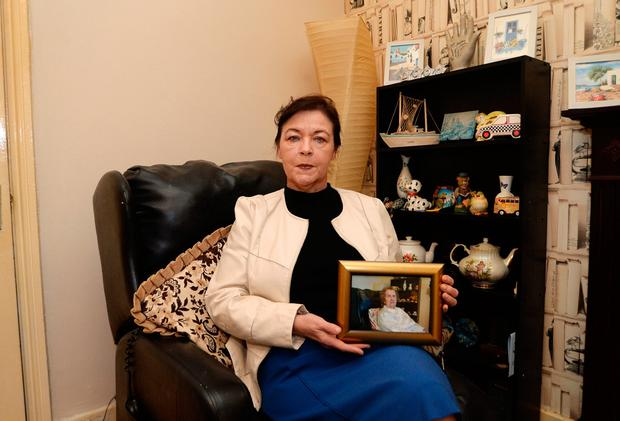 Helen Moore, pictured with a photo of her late mum Peg. Photo: Caroline Quinn
