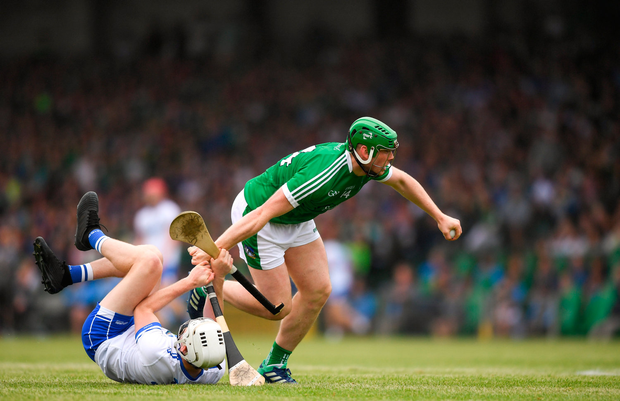 10 June 2018; Shane Dowling of Limerick is tackled by Shane McNulty of Waterford during the Munster GAA Hurling Senior Championship Round 4 match between Limerick and Waterford at the Gaelic Grounds in Limerick. Photo by Eóin Noonan/Sportsfile