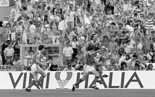 Republic of Ireland's Ray Houghton celebrates his goal against England with team-mates Ronnie Whelan and John Aldridge, left. Photo: Ray McManus/SPORTSFILE