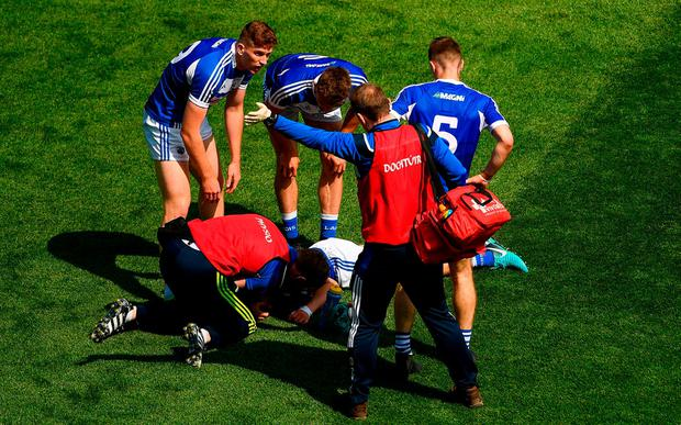 Laois captain Stephen Attride receives medical attention after accidentally colliding with Ciarán Moran of Carlow. Photo: Piaras Ó Mídheach/Sportsfile
