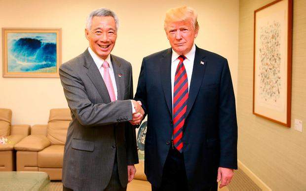 Donald Trump with Singapore's Prime Minister Lee Hsien Loong. Photo: (MCI)/via Getty Images)