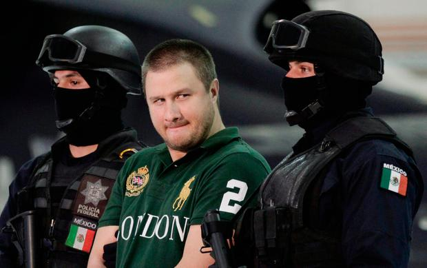 Edgar Valdez Villarreal under Mexican federal police escort. Photo: REUTERS