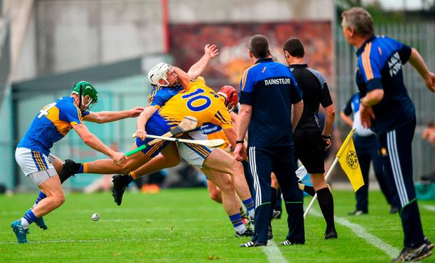 Tipperary's Brendan Maher collides with Peter Duggan of Clare during Sunday's clash in Semple Stadium. Photo: David Fitzgerald/Sportsfile