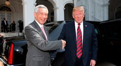 In this handout provided by the Ministry of Communications and Information of Singapore, U.S. President Donald Trump (R) with Singapore's Prime Minister Lee Hsien Loong (L) on June 11, 2018 in Singapore, Singapore. Photo by Ministry of Communications and Information Singapore/via Getty Images