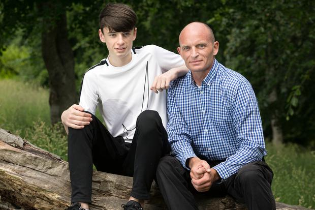 Platelette donor John Egan with his son Jake, whose life was saved thanks to a donor. Photo: Tony Gavin