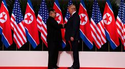 U.S. President Donald Trump shakes hands with North Korean leader Kim Jong Un at the Capella Hotel on Sentosa island in Singapore June 12, 2018. REUTERS/Jonathan Ernst