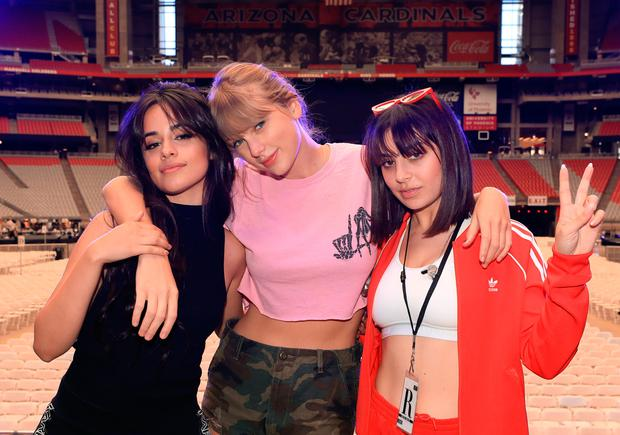 (L-R) Camila Cabello, Taylor Swift, and Charli XCX pose onstage before opening night of Taylor Swift's 2018 Reputation Stadium Tour at University of Phoenix Stadium on May 8, 2018 in Glendale, Arizona. (Photo by Christopher Polk/Getty Images for TAS)