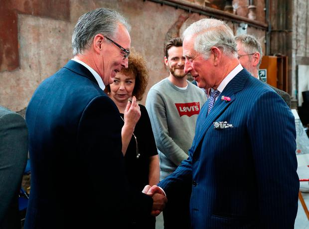 Britain's Prince Charles shakes hands with Sinn Fein MLA Gerry Kelly. Photo: Brian Lawless/PA Wire