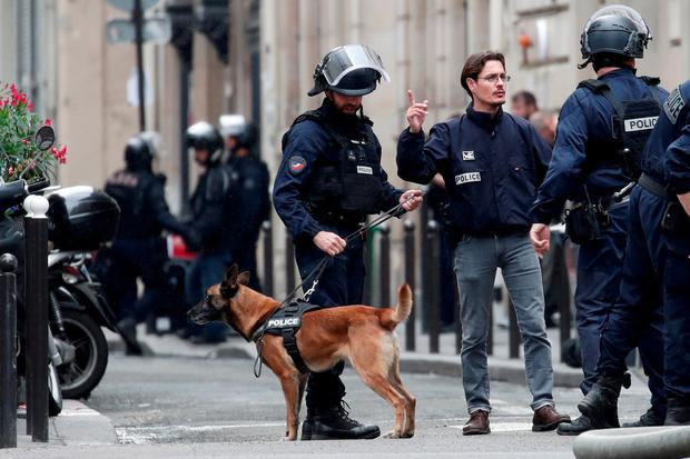 French police with their dog secure the street as a man has taken people hostage at a business in Paris, France, June 12, 2018. REUTERS/Benoit Tessier