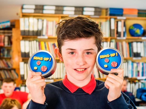 Aaron McHugh, a pupil at Killeshandra National School in Cavan, pictured with 'Sum's Up' a maths game created by himself and his classmates for the Junior Entrepreneur Programme. Photo: Jerry Kennelly/JEP