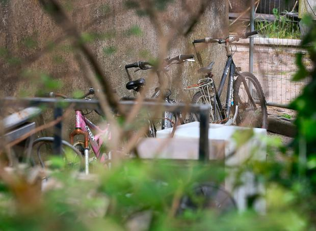 Family bikes in the back garden of the house in Maglin, near Ballincollig, Co Cork, where Mikolaj Wilk was killed and his wife Elzbieta was seriously injured in a machete attack on Sunday morning. Photo: Frank McGrath