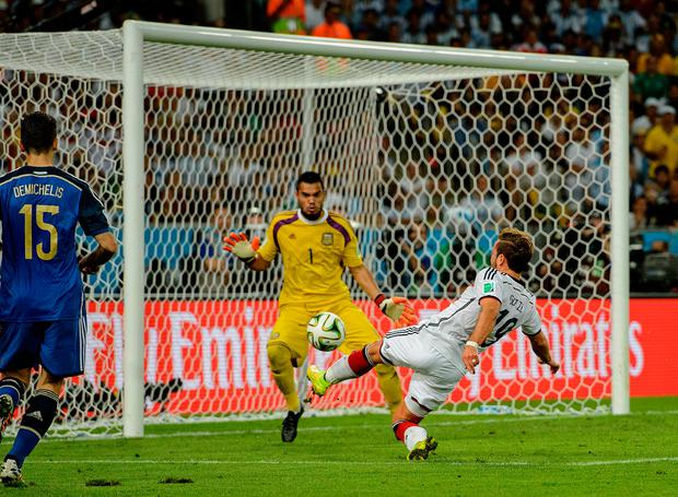 Mario Goetze of Germany scores the winning goal against Argentina in the 2014 final. Photo: Matthias Hangst/Getty Images