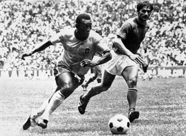 Brazilian Pelé dribbles past Italian defender Tarcisio Burgnich in the 1970 World Cup final in Mexico City. STAFF/AFP/Getty Images