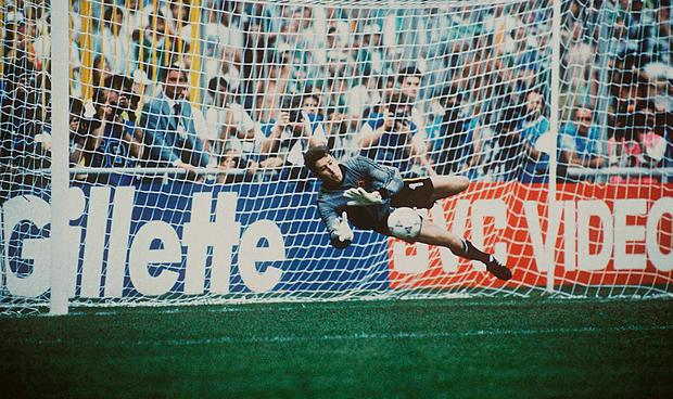 On the ball: Packie Bonner saves Daniel Timofte's shot during the penalty shoot-out against Romania in the1990 World Cup. Photo: Sportsfile...ABC