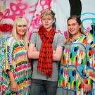 Family: Halle (left) wears 'Tiki' dress with frilled V-neck in grey tribe print, €755; Ronnie wears red 'Oscar' cashmere scarf, €150; Helen wears 'Sharjah' dress in white tribe print, €550, all these pieces available exclusively from helensteele.com Photo: Frank Mc Grath