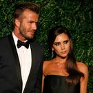 Former England football captain David Beckham and his wife Victoria (R) pose on the red carpet as they attend the 60th London Evening Standard Theatre Awards 2014 in London on November 30, 2014. AFP PHOTO / JUSTIN TALLIS