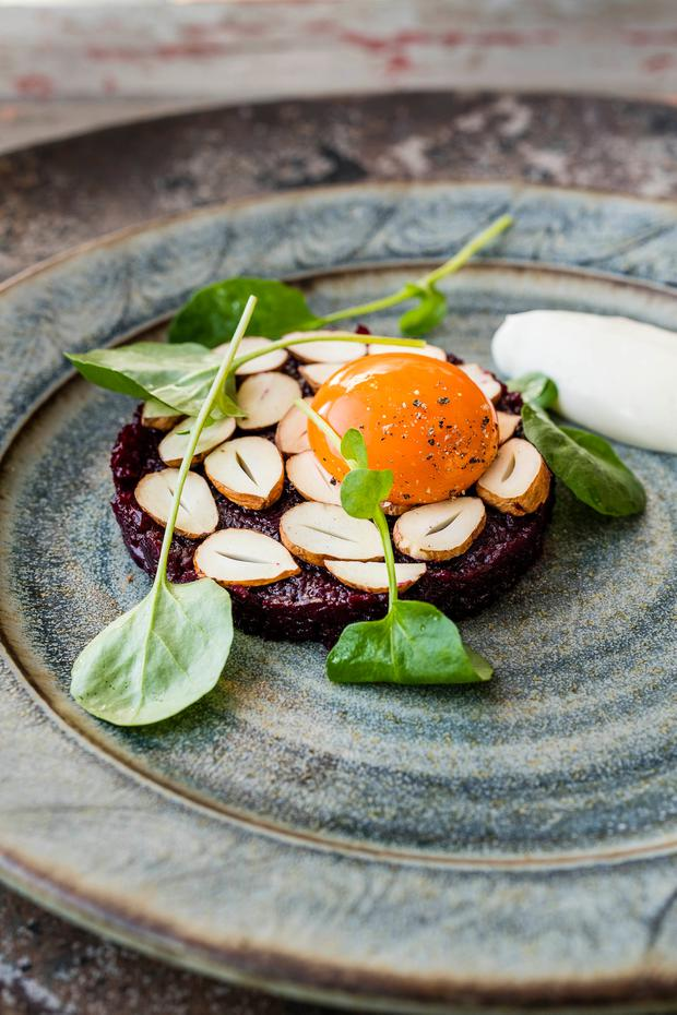 Smoked beetroot tartare, Cacklebean egg yolk, hazelnut. Photography © Paul Winch-Furness