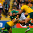 Sean Cronin of Ireland is tackled by Bernard Foley and Israel Folau of Australia