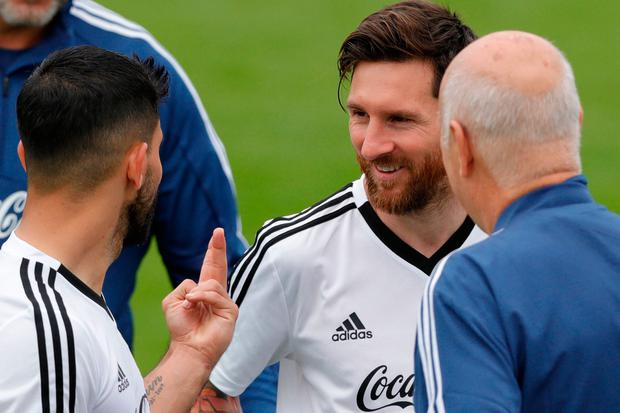 Sergio Aguero, left, talks to Lionel Messi during a training session
