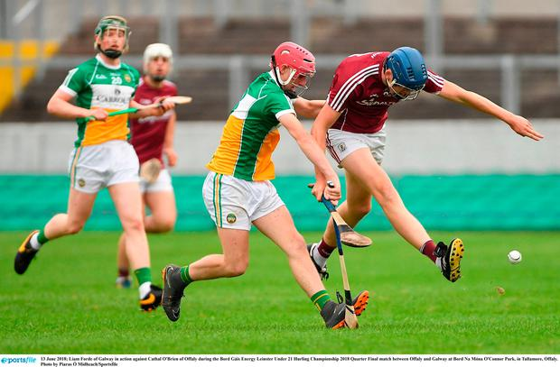 Liam Forde of Galway in action against Cathal O'Brien of Offaly