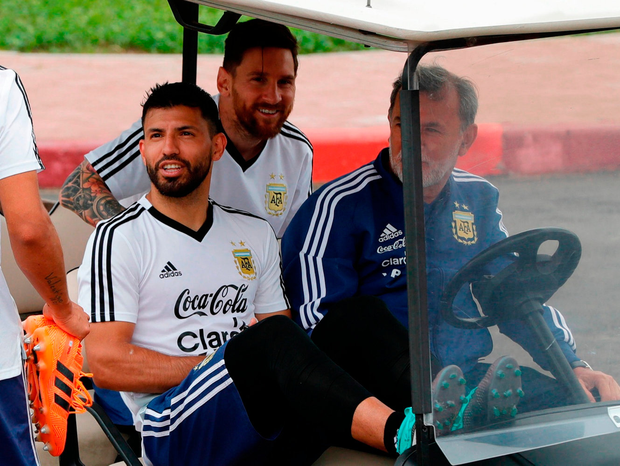 Strikers Sergio Aguero, left, and Lionel Messi ride a golf cart after a training session in Bronnitsy, Russia, yesterday. Photo: Ricardo Mazalan/AP