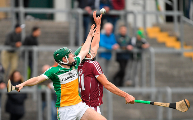 Cian Salmon of Galway in action against Cathal O'Meara of Offaly. Photo: Sportsfile