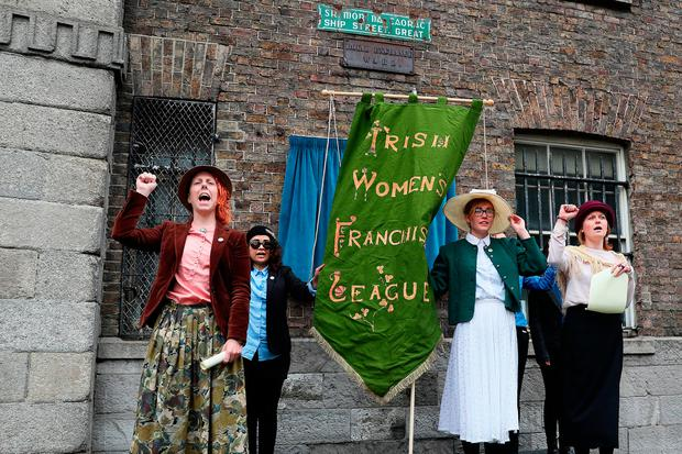Galway Feminist Collective members read the names of jailed Irish suffragettes as the Hanna Sheehy Skeffington plaque is unveiled by President Higgins. Photo: Brian Lawless/PA Wire