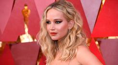 Showstopper: Jennifer Lawrence showed off her modern perm at the Oscars. Photo: Getty Images