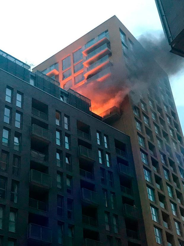 Picture taken with permission from the Twitter feed of @yusif0ali showing a fire on the 12th floor of a 20-storey tower block in Elmira Street, Lewisham, south London. Yusif Ali/PA Wire