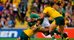 9 June 2018; Sean Cronin of Ireland is tackled by Bernard Foley and Israel Folau of Australia during the 2018 Mitsubishi Estate Ireland Series 1st Test match between Australia and Ireland at Suncorp Stadium, in Brisbane, Australia. Photo by Brendan Moran/Sportsfile