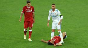 Mohamed Salah was hurt during a clash with Real Madrid's Sergio Ramos (Peter Byrne/PA)