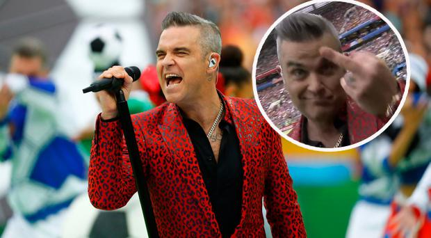 Robbie Williams performing in Russia and (inset) he gives the middle finger