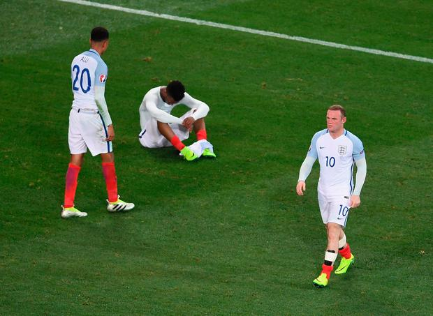 Wayne Rooney of England walks from the pitch as Dele Alli and Daniel Sturridge show their disappointment after defeat against Iceland at Euro 2016