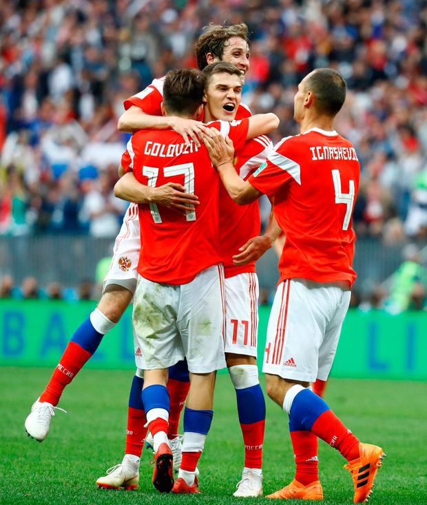 Russia's Aleksandr Golovin celebrates scoring their fifth goal with team mates