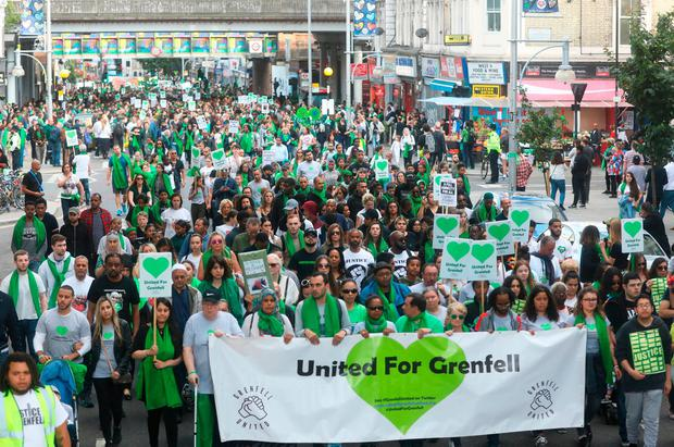 Thousands take part in silent march to mark first anniversary of people take part in a silent walk by grenfell tower to mark one year since malvernweather Choice Image