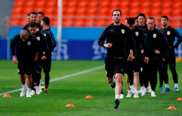 Uruguay captain Diego Godin leads his teammates during training at the Ekaterinburg Arena, Yekaterinburg, Russia. Photo: REUTERS/Andrew Couldridge
