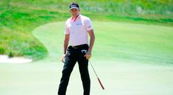 Poulter carded a one-under-par 69 to join American Scott Piercy at the top of the leaderboard at Shinnecock Hills. Photo by Ross Kinnaird/Getty Images