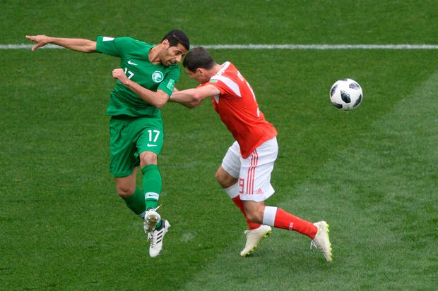 Saudi Arabia's midfielder Taisir Al-Jassim (L) and Russia's midfielder Alan Dzagoev compete for the ball. Photo; Getty Images