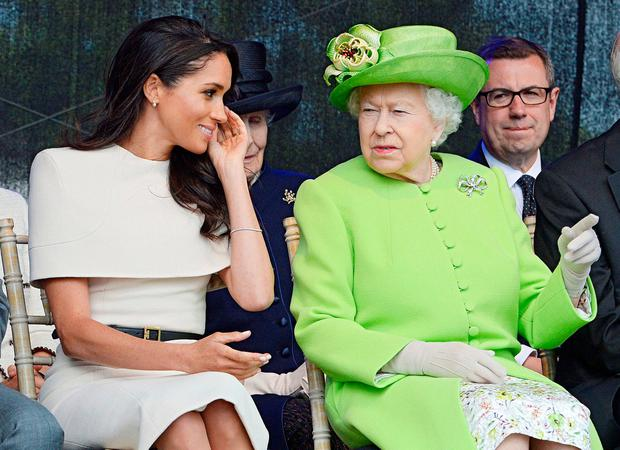 The Duchess of Sussex and Queen Elizabeth attend the opening of the Mersey Gateway Bridge in Runcorn, Cheshire, yesterday. Photo: Jim Clarke/Pool via Reuters